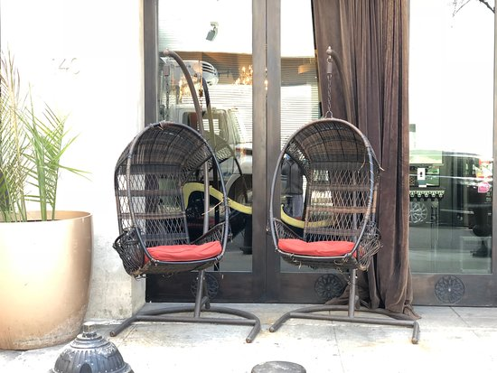 Casa La Femme : Relax, hanging chairs got you. this is more done up in summer time with tables and plants.