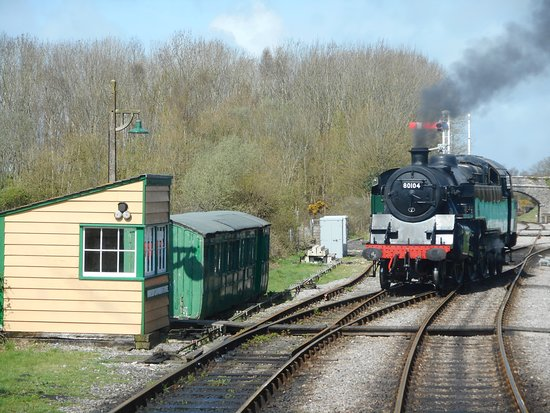 Swanage Railway: The Standard tank engine runs round to the front of the train at Norden.