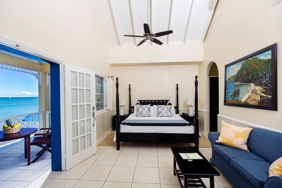 Villa Beach Cottages: One Bedroom Villa Suite - Four Poster Bed