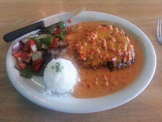 Sin Fronteras Cafe: Crispy sauteed pork w/ onion, cilantro & topped w/ green tomatillo sauce, served w/ white rice.