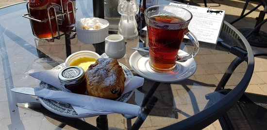 "Earls Colne, UK: ""Cream tea"". Delicious, don't know how hey keep the glass cups so clean."