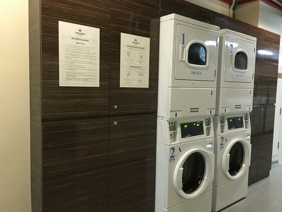 Self-service laundromat  Purchase tokens from Concierge