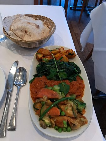 Variety of vegetable dishes and one of their flat breads