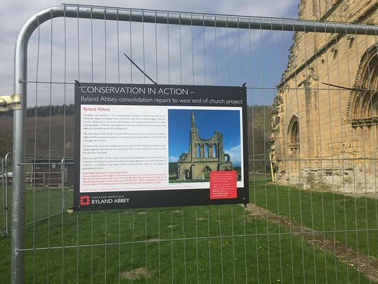 Coxwold, UK: Sign on the far right hand side of the metal fencing not visible as you enter the site