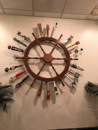 Shippensburg, PA: Nice blooming tree view from outside the window. Beer Captain wheel of taps.