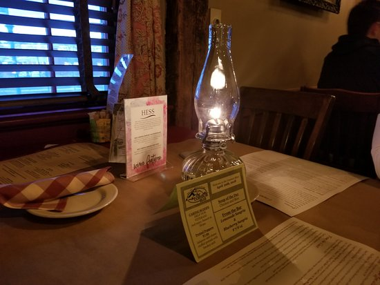 The Common Man: our beautifully decorated table with warm lighting (actual oil lamp)