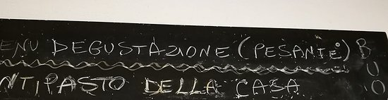 San Colombano Certenoli, Italia: lavagna del menù giornaliero.