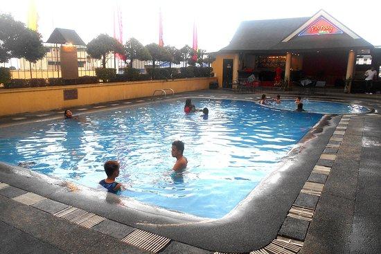 The Royal Mandaya Hotel: The hotel pool and bar.