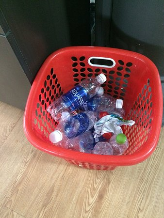 One of a few bins at Superfit full of plastic water bottles.