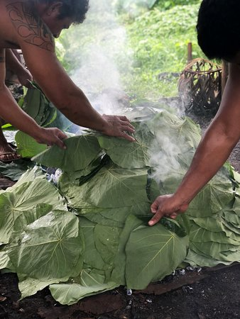 Taufua Beach Fales: Traditional Umu being prepared