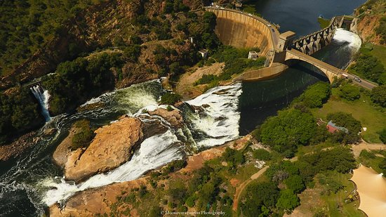 Hartbeespoort Dam: Drone coverage overlooking the dam ,one of the sluice gates open