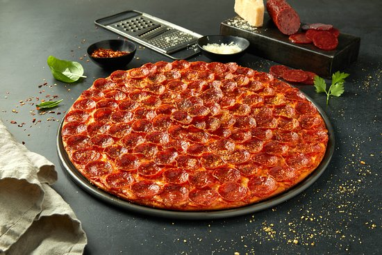 Independence, KY: Pepperoni Pizza: Loaded Edge to Edge® with our famous pepperoni—100 pieces on every large!