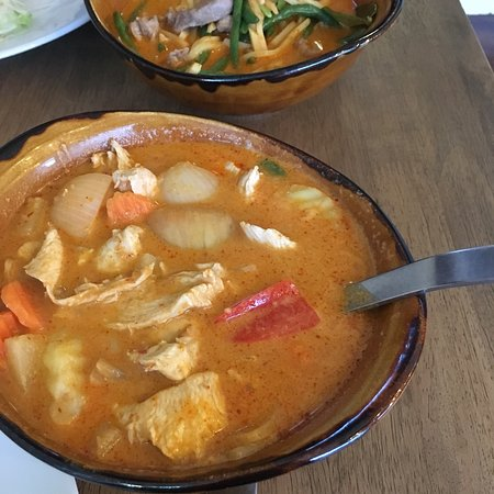 Delicious fresh Thai food. Massaman curry with chicken and red curry with lamb.