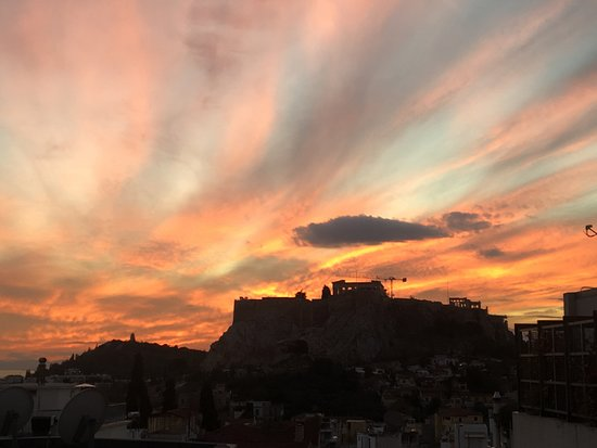 New Hotel: Acropolis view at sunset from the rooftop restaurant