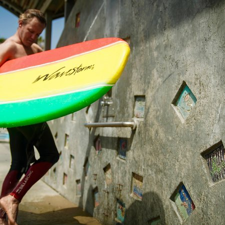 There are public showers where we surf in Venice : )   Picture of