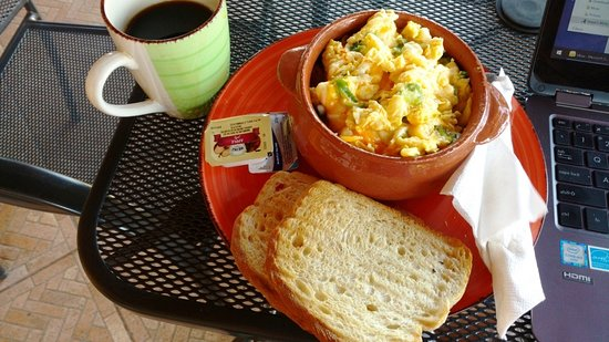 Sugar & Spice Dulces Gourmet: Cheese Green Onion Omelette on crispy potatoes $6