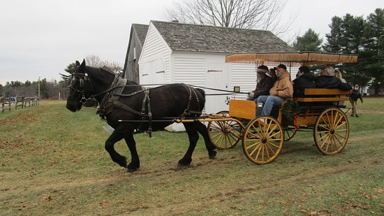 New London, NH: Visitors to Dashing Through the Snow Open House (First Sunday of December) enjoy a carriage ride
