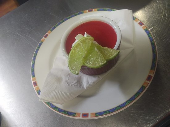 Frozen Cheesecake Flan Served with strawberry daiquiri sauce