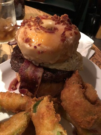 Newport, NH: Burger topped with an egg, bacon, and cheese, Between two glazed donuts topped w/ crumbled Bacon