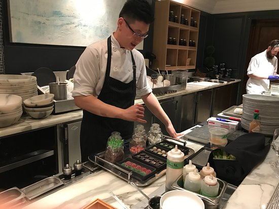 Sutton Place Hotel Vancouver: Chef Johnny as assistant Jimmy at work doing their magic with seafood and showing a dessert