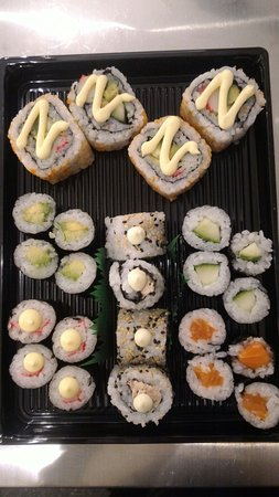 California roll, tuna wasabi mayo urmakai and avocado, crab stick, cucumber and salmon maki.