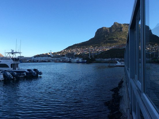 The Lookout Deck Hout Bay Restaurant, Bar & Sushi: The infamous Hangberg looms ove harbour