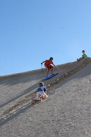 Hawks Nest, Australia: Sliding down the sand dunes