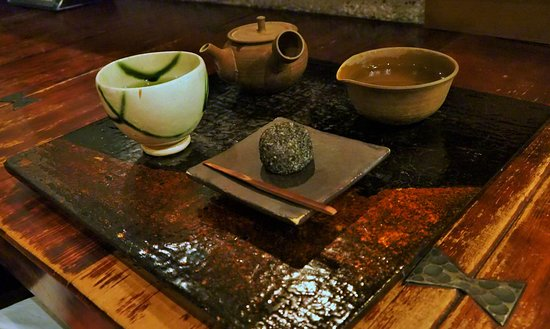 A serving of tea at Chanoha: tea in pot, hot water, bowl for drinking, and sweet.