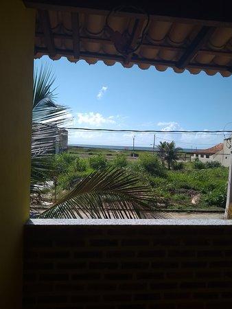Guriri, ES: Varanda de quarto com vista para o mar.