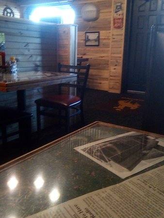 each table has old newspaper articles from Torrington's past