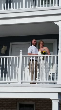 Mr. & Mrs. Hartman pose for a picture on the balcony of The Heritage Inn after saying I do!