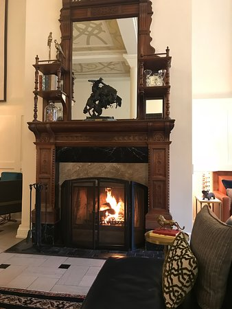 The Oxford Hotel: Fire stoked for Spring snow shower! Remington sculpture on mantle