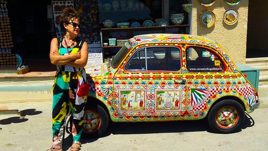 Fiumicino, Italy: A fiat 500 decorated as the traditional Sicilian caretto, Parked outside a cafe near Selinunte