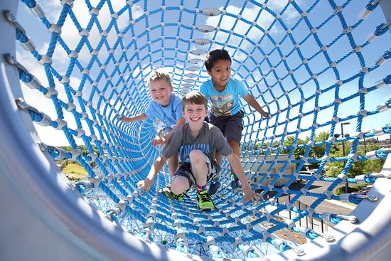 Greensboro Children's Museum: Children in tunnel at Outdoor Play Plaza