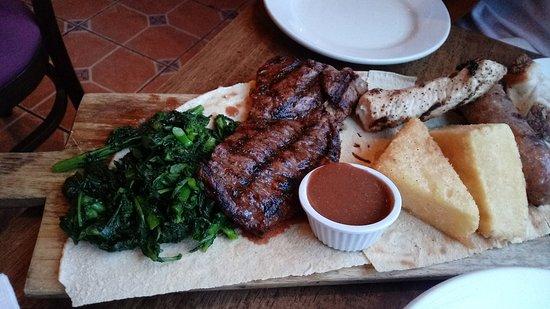 Arco Cafe: Grigliata Mista 26 Sausage, skirt steak & chicken breast over Pane Carasau, fried polenta & bro