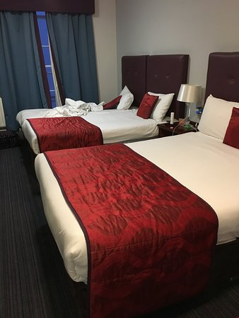 The Belvedere Hotel: all beds made except for the last bed with dirty towels on it