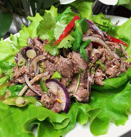 Shawville, Canada: Sliced grilled beef with grounded sticky rice red chilies, mixed in Thai dressing