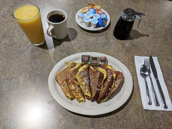 Grandville, MI: 3 Delicious Slices of French Toast made with Cinnamon Bread