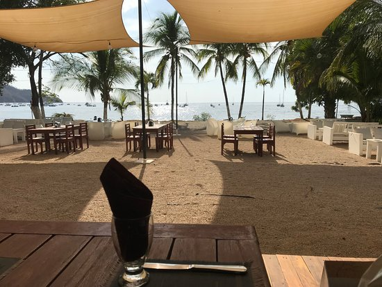 View of the beach dining area and bay from Cafe de Playa, Playas del Coco, Costa Rica.