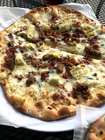 Ammon, ID: Italian pizza with sausage, bacon, artichokes...