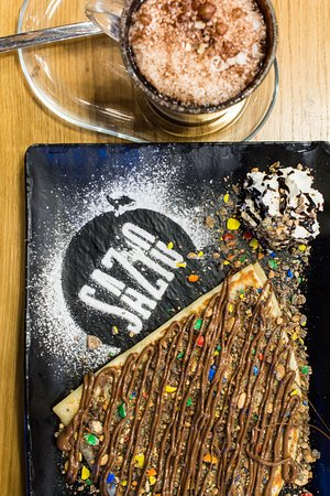Sazio: Our crepe nutella M&Ms with a hot chocolat