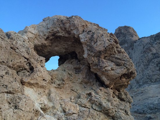 Trona Pinnacles: Here's that hole and my friends watching the spires nearby, from a chair we brought....take pics