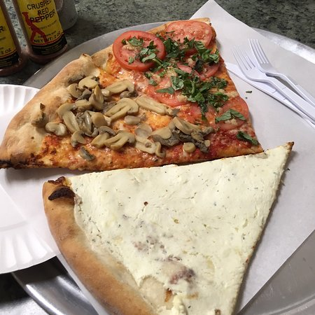 Mamaroneck, NY: A slice of white pizza and a slice of tomato with basil and a slice mushroom