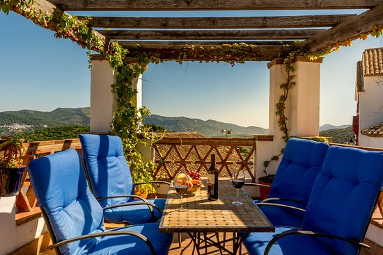 Cartajima, Spain: Guests love to sit under the pergola with bottle of something lovely