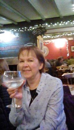 Lorton, UK: Mrs K enjoys one of the fantastic range of gins available at the Wheatsheaf