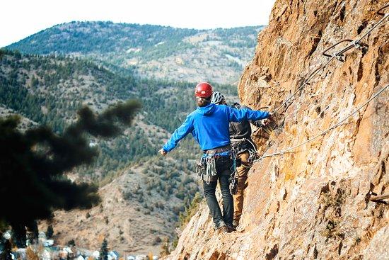 A man in a blue jacket on the Mount Evans Via Ferrata