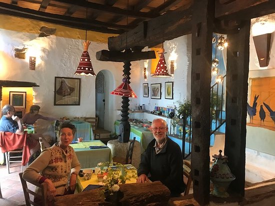 La Fructuosa: The guest house owners in the dining room (shows the grape press)