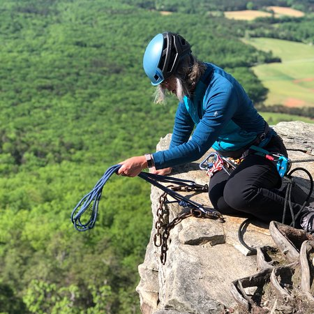 Practicing top rope anchors at Pilot Mountain's climbing area.