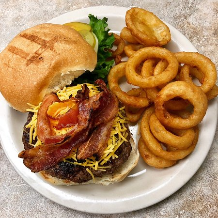 Chalmette, LA: Brewster burger topped with bacon served with a side of onion rings