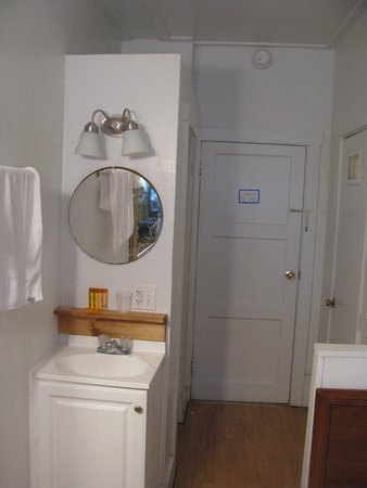 Petersburg, WV: old chain on panel door, cheap door knob and mini vanity